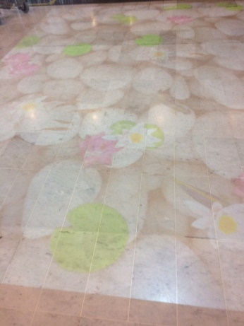 A cool koi pond projected on the floor at the airport